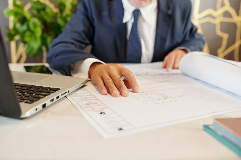 Company owner checking building blueprint